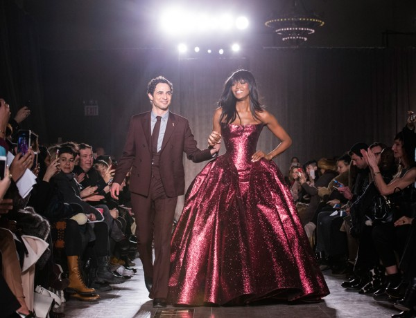 Designer Zac Posen and model Naomi Campbell greet the crowd after his Fall 2015 collection is modeled during Fashion Week, Monday, Feb. 16, 2015, in New York. (AP Photo/John Minchillo)