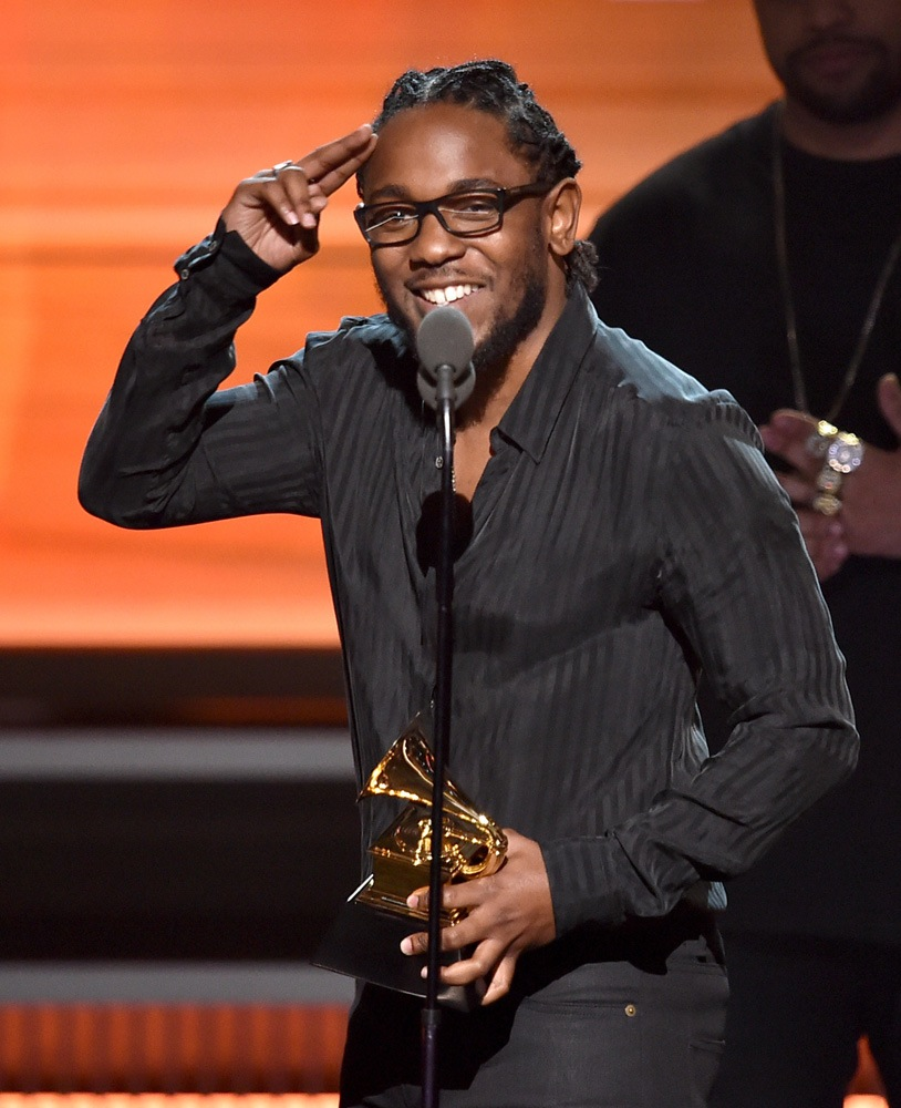 Kendrick Lamar accepting one of his 5 Grammy wins for the night