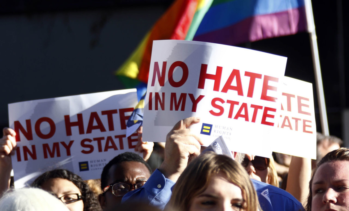 Protesters call for Mississippi Gov. Phil Bryant to veto House Bill 1523, which they says will allow discrimination against LGBT people, during a rally outside the Governor's Mansion in Jackson, Miss., Monday, April 4, 2016. (AP Photo/Rogelio V. Solis)