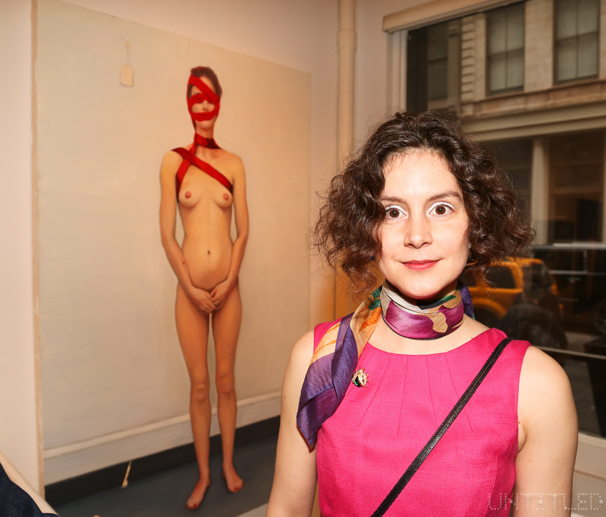 "Artist Loretta Mae Hirsch at ""In The Raw: The Female Gaze on The Nude"" Exhibit Opening - The Untitled Space Gallery, New York. Photography by Dustin Wayne Harris"