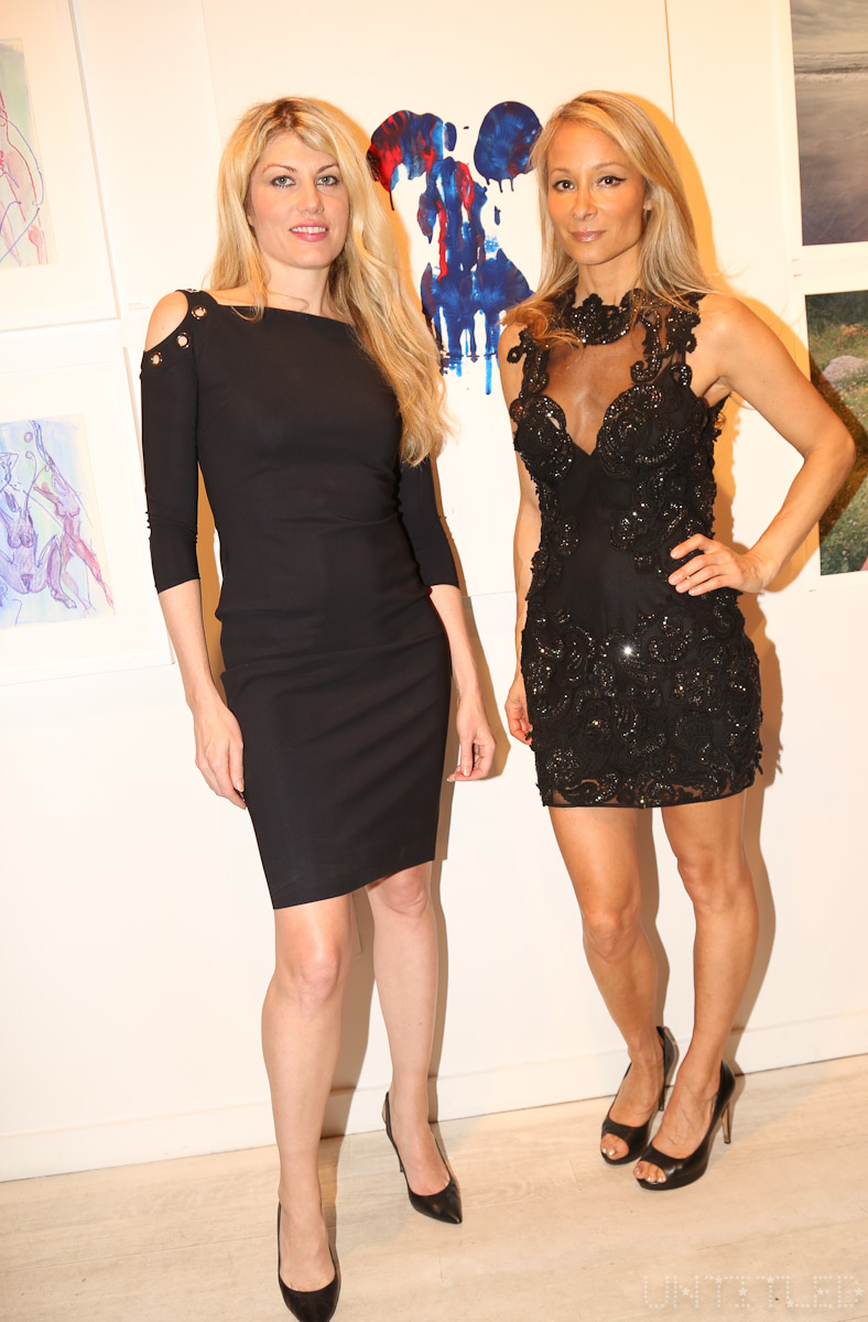 "Artists Meredith Ostrom and Indira Cesarien at ""In The Raw: The Female Gaze on The Nude"" Exhibit Opening - The Untitled Space Gallery, New York. Photography by Dustin Wayne Harris"