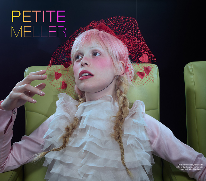 Petite Meller photographed by Julia Fullerton-Batten for The Untitled Magazine #GirlPower Issue. Petite wears a playsuit with ruffles by By Sun, and a red hat with heart netting by Julia Clancey.