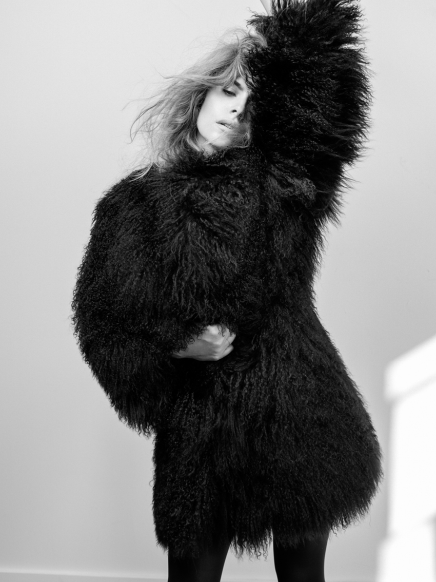 Tatiana wears a mongolian coat by Adrienne Landau and opaque thigh highs by Falke.