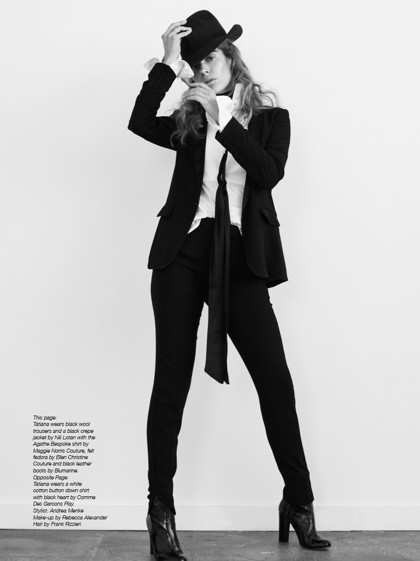 Tatiana wears black wool trousers and a black crepe jacket by Nili Lotan with the Agathe Bespoke shirt by Maggie Norris Couture, felt fedora by Ellen Christine Couture and black leather boots by Blumarine.