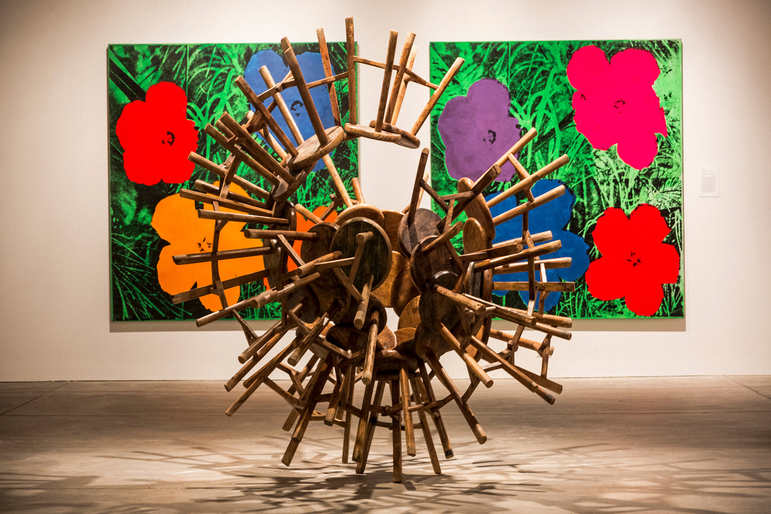"Ai Weiwei's ""Grapes"" and Andy Warhol's ""Flowers"" in the show ""Andy Warhol/Ai Weiwei."" Photograph by Chad Batka for The New York Times"