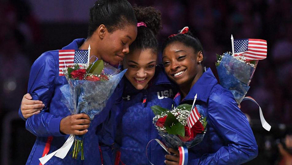 Gabby Douglas, Laurie Hernandez, and Simone Biles of the 2016 U.S. Women's Olympic Gymnastics Team // Courtesy of USA Today Sports + Kyle Terada