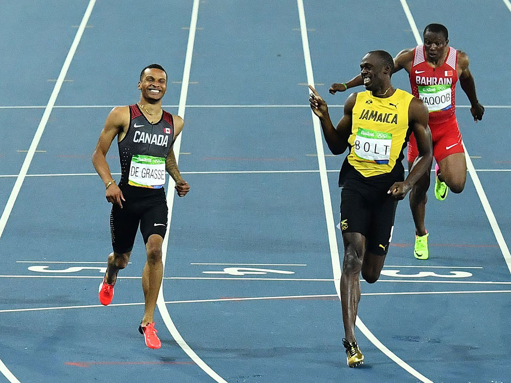 Usain Bolt gives props to his second place competitor in the Rio Olympics. Image courtesy of Getty.