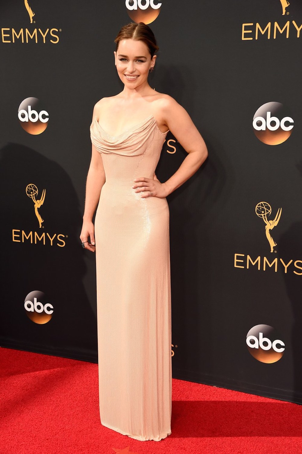 Emilia Clarke in Atelier Versace at the 2016 Emmy Awards. Image courtesy of Kevin Mazur/Getty.