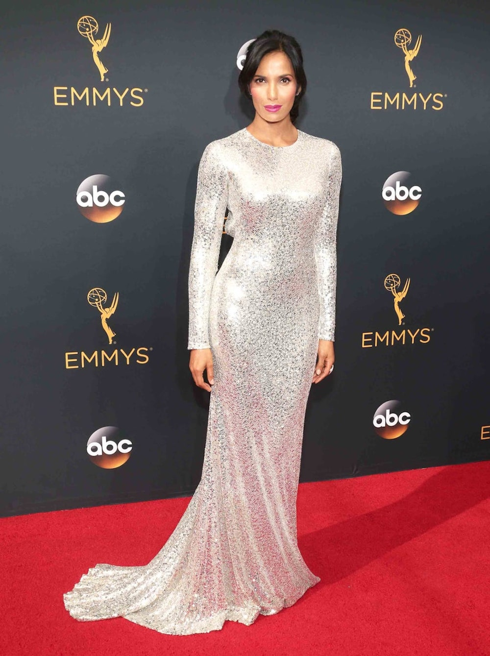 Padma Lakshmi in Naeem Khan at the 2016 Emmy Awards. Image courtesy of Tod Williamson/Getty.