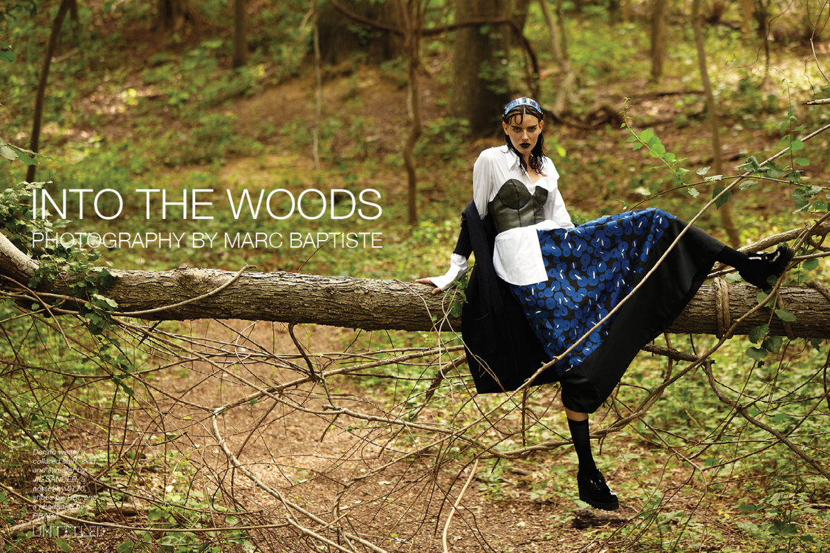 """Into The Woods"" Photographed by Marc Baptiste for The Untitled Magazine. Dorato wears a collared shirt, skirt, and sweater by JIL SANDER, a corset by 0770, shoes by TIBI, and a headband by PRADA."