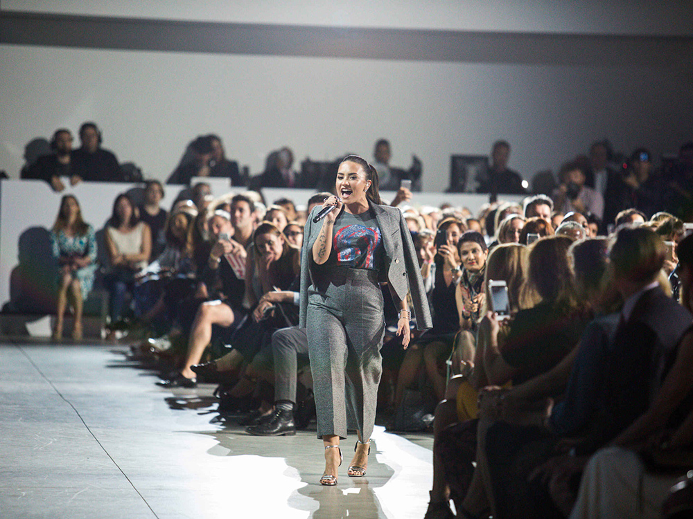 Demi Lovato performs at the Made For History Fashion Show. Image courtesy of Hillary for America.