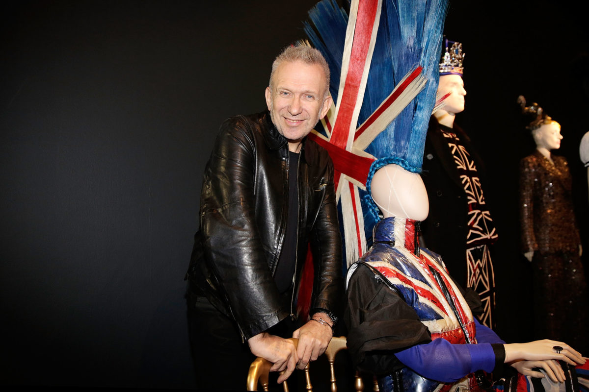 LONDON, ENGLAND - APRIL 07:  Jean Paul Gaultier poses with a metre high mohican in the Punk Cancan section of 'The Fashion World of Jean Paul Gaultier: From the Sidewalk to the Catwalk'  at the Barbican Art Gallery on April 7, 2014 in London, England. This is the first major exhibition devoted to the celebrated French couturier, and runs from 9 April to 25 August.  (Photo by Matthew Lloyd/Getty Images)