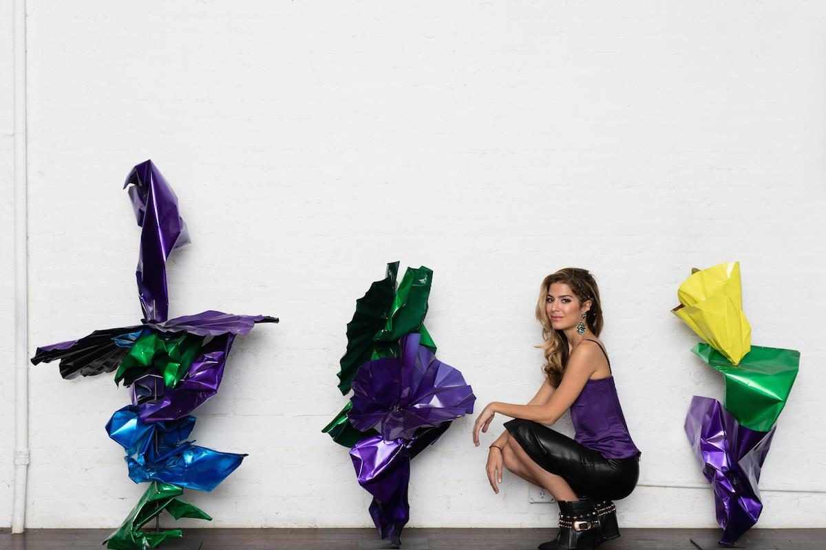 Fidan Bagirova with her latest work, 'Voyage En Fleurs.' Image styled and curated by Stacy Engman, courtesy of the artist.