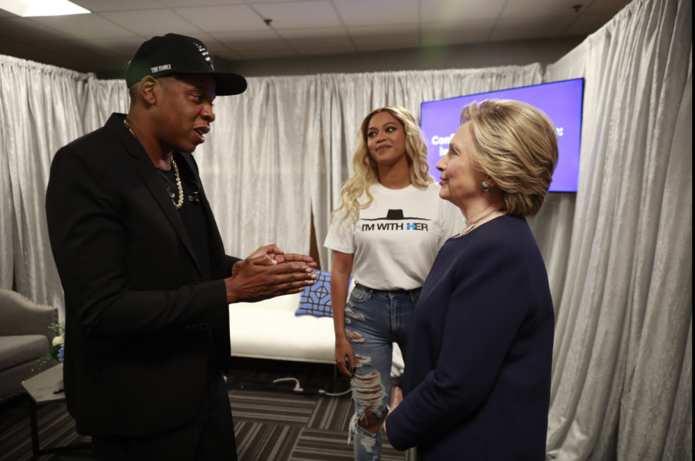 Hillary Clinton backstage with Jay Z and Beyoncé in Cleveland. Doug Mills/The New York Times.